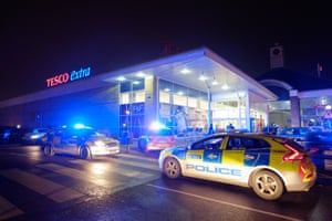 """Police presence outside Lee Valley Tesco Extra in north London on on """"Black Friday"""", November 28, 2014. Police officers later advised the store to close to avoid problems with over-zealous shoppers. Photograph: Frantzesco Kangaris"""