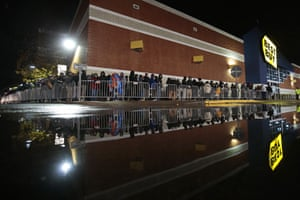 Shoppers queue outside the Best Buy in Dartmouth