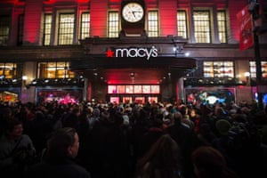 Shoppers count down to opening time outside Macy's in New York