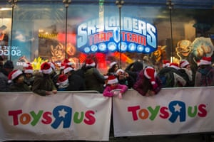 Queues build up outside the Toys R Us store in Times Square, New York