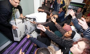 Shoppers at the Asda store in Wembley, north west London take advantage of the store's Black Friday offers