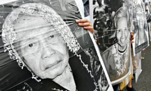 Supporters hold portraits of women who were forced to work in Japanese brothels