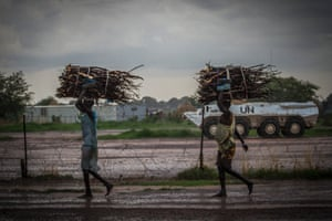 Locals collect firewood outside UN protected airstrip, South Sudan