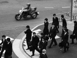 Black suits leaving the office in Shinjuku