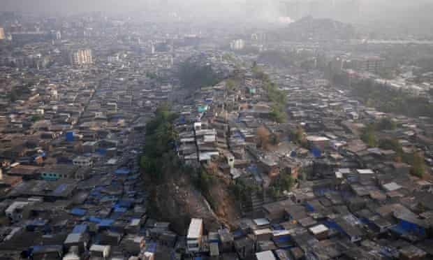 A slum surrounds a noll known to locals as 'Hill 3' in Mumbai's northern slums.