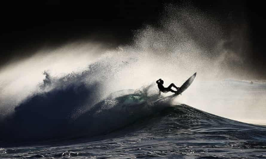 A surfer falls from his board in Sydney, Australia.