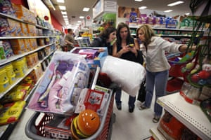 Shoppers use a smartphone to look at a competitor's prices whilst in Target