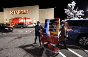 Shannon Johnson and Elizabeth Withers, of Windham, Maine, wheel a 48-inch flat-screen TV to their car