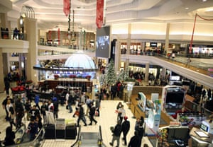 Shoppers walk through Woodfield Mall after midnight in Schaumburg, Illinois