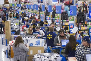 Customers at the tills of a Walmart store in Bentonville, Arkansas..