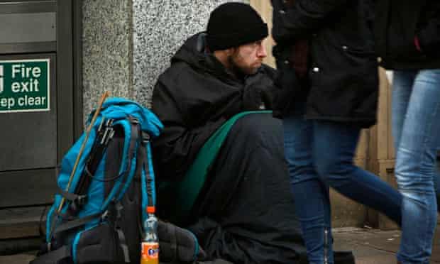 Man begging outside a bank