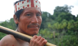 Matsés man Alesandro Dunu Mayoruna, from Sao Meireles village in Brazil, painted with achiote to receive visitors and talk about oil company Pacific Rubiales.