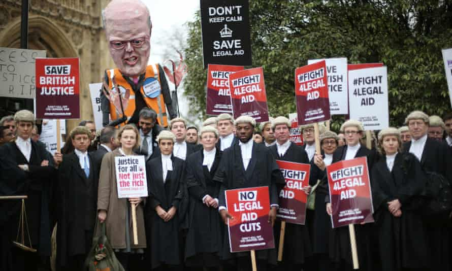 Barristers and solicitors demonstrating against legal aid cuts outside Parliament in March this year.