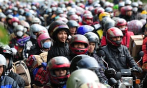 Migrant workers drive motorcycles returning to their remote Guangxi, Guizhou and Sichuan provinces hometown.