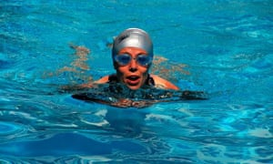 A woman swims in an  outdoor hotel swimming pool. Image shot 2008. Exact date unknown.