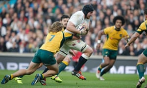 England's Ben Morgan, the man of the match,  charges through the Australian defence on his way to scoring his, and England's, first try of the game.