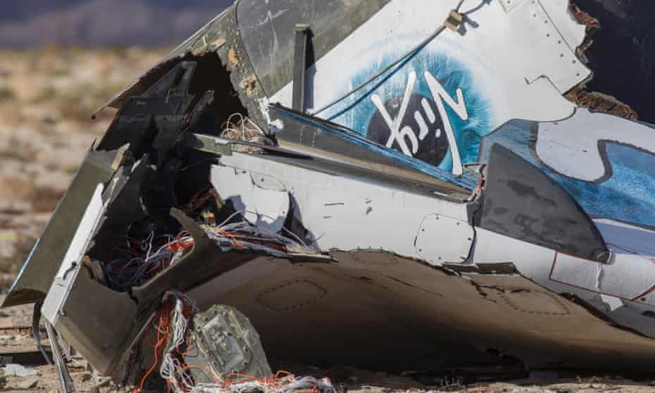 Wreckage lies near the site where a Virgin Galactic space tourism rocket, SpaceShipTwo, exploded and crashed in Mojave, Calif. Saturday, Nov 1, 2014. The explosion killed a pilot aboard and seriously injured another while scattering wreckage in Southern California's Mojave Desert, witnesses and officials said. (AP Photo/Ringo H.W. Chiu)