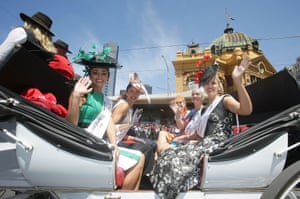 Participants from Fashions On The Field take part in the 2014 Melbourne Cup parade