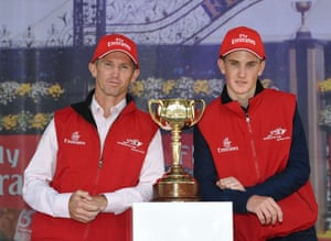 Glyn Schofield and son Chad Schofield pose with the 2014 Melbourne Cup