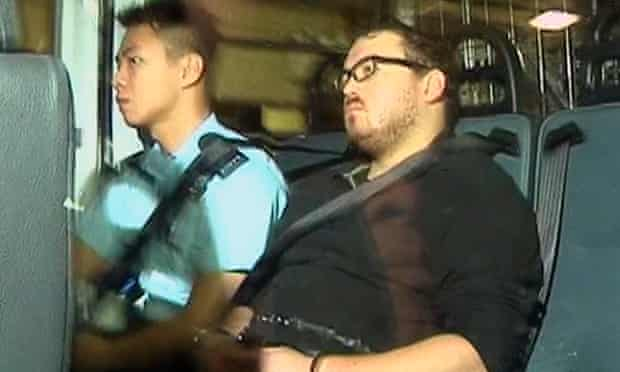 Rurik Jutting in a police van as it arrives at a court in Hong Kong.