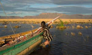 A Turkana man prepares for a day fishing on Lake Turkana in northwestern Kenya. The Turkana region is short of basics like grass and groundwater, but contains other resources including oil reserves and newly-discovered massive underground aquifers.