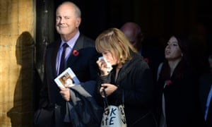 Gyles Brandreth and his wife Michele Brown after the funeral at St Bartholomew's church.