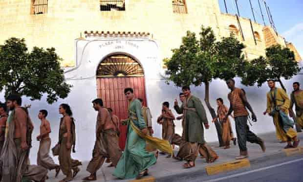 Some of Game of Thrones' 550 extras leaving Osuna's bullring. Photograph: Cristina Quicler/AFP/Getty