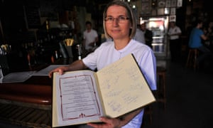 Restaurant owner Teresa Jiménez with her menu of dishes named after Game of Thrones characters. Photograph: Cristina Quicler/AFP/Getty Images