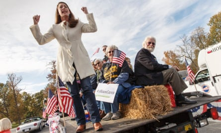 Democratic candidate Alison Lundergan Grimes, fires up her supporters at the start of the Veterans Day Parade in Madisonville, Kentucky.