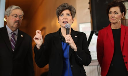 Senate candidate Joni Ernst, flanked by Iowa Governor Terry Branstad and Iowa Lieutenant Governors Kim Reynolds, speaks during a campaign stop at the Amtrak Osceola Train Depot in Osceola, Iowa.