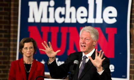 Former President Bill Clinton speaks as Democratic candidate for Senate Michelle Nunn looks on during a rally in Atlanta, Georgia.