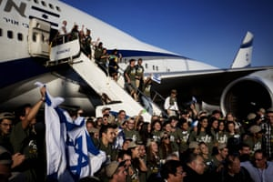 New immigrants to Israel from the US and Canada celebrate as they arrive at Ben-Gurion airport, near Tel Aviv.
