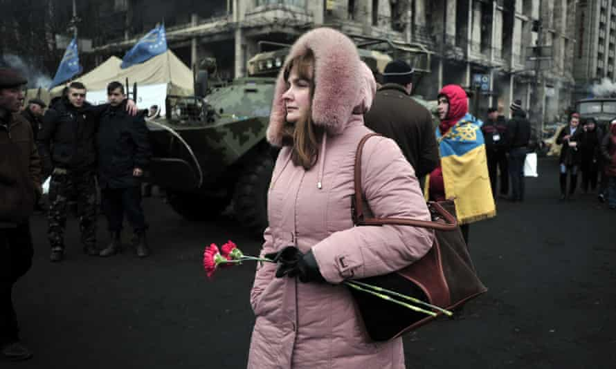 A woman walks through Maidan Square in Kiev, Ukraine.