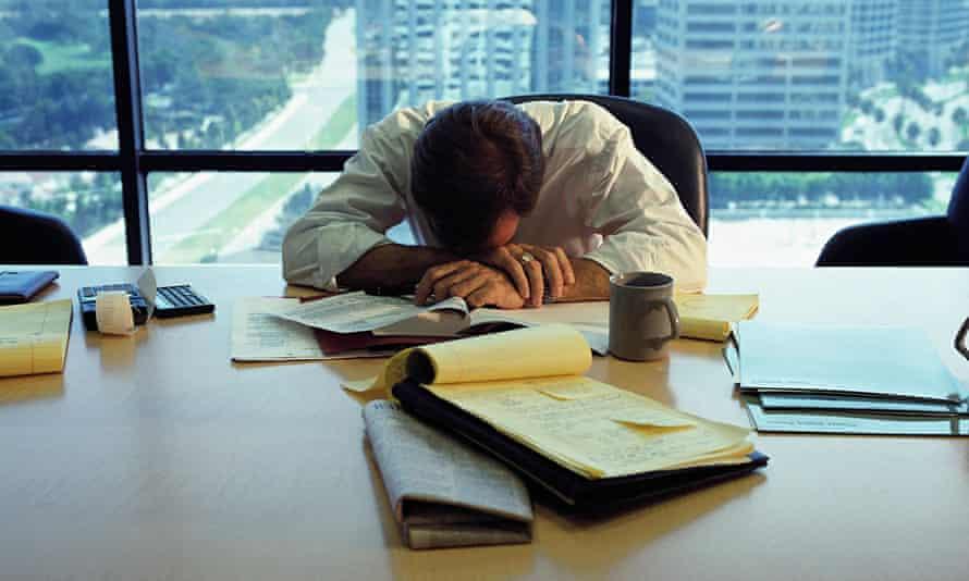 City worker asleep at desk