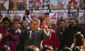 Minnesota congressman Keith Ellison leads the crowd in a chant of 'Change the Name' during a rally before the Vikings faced the Washington team on Sunday.