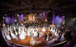 Dozens of debutantes dance the Waltz of the Flowers from Tchaikovsky's Nutcracker.