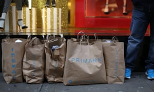 Customers wait with their purchases outside Primark's flagship store on Oxford Street.