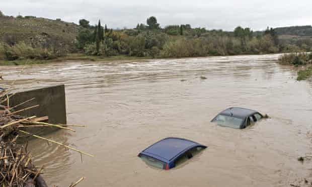 The roofs of flooded cars are seen in the river Berre at Portel les Corbieres, southern France,