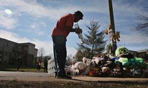 A man plays the trumpet at a memorial to Michael Brown in Ferguson, Missouri