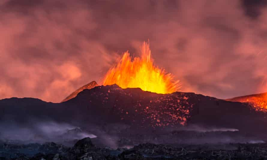 A volcanic eruption seen from a distance on September 12, 2014 in Holuhraun, Iceland.  A new study concludes that small volcanic eruptions have been a significant contributor to the slowdown in global surface warming.