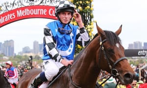 Melbourne Cup 2014 winner Protectionist: Ryan Moore salutes the crowd.