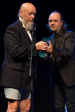 Michael Eavis accepts the Music Industry Trust Award 2014 from Lars Ulrich.