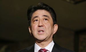 PM Shinzo Abe briefs reporters on his talks with a Japanese envoy who visited North Korea.