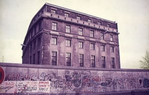 The Berlin Wall ran directly behind the Reichstag. The building in the photograph was one of the few East Berlin buildings allowed to remain next to the Wall. The windows had iron bars to keep people from jumping out to escape to the west