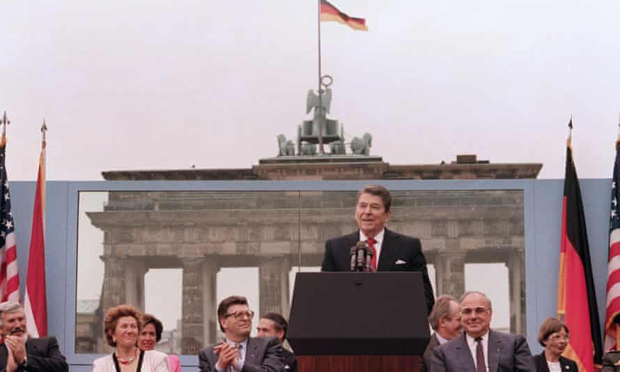 US President Ronald Reagan, commemorating the 750th anniversary of Berlin, addresses on June 12, 1987 the people of West Berlin at the base of the Brandenburg Gate, near the Berlin wall.