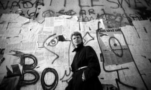 David Bowie photographed in front of the Berlin Wall in 1987.