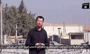 An image grab taken from a video released by the Islamic State (IS) group group via Youtube on October 27, 2014 purportedly shows 43-year-old kidnapped British reporter John Cantlie
