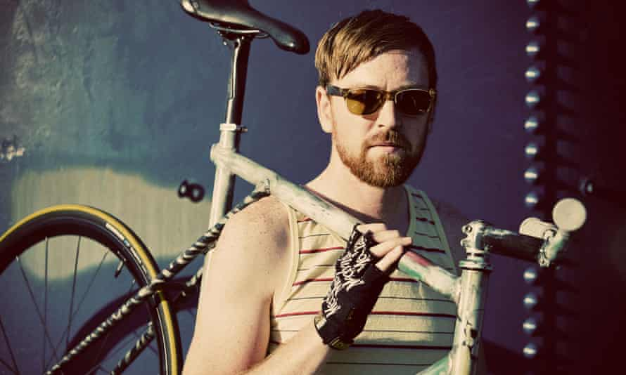 a fixed gear bike and its bearded owner.