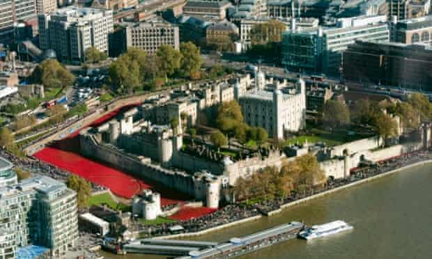 London, UK An aerial view from The Shard of visitors looking at Tower of London's 'Blood swept Lands and Seas of Red' poppy installation by artist Paul Cummins at the Tower of London