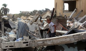 A child amid rubble after 800 families in Rafah were given 48 hours to leave their homes on Sinai's
